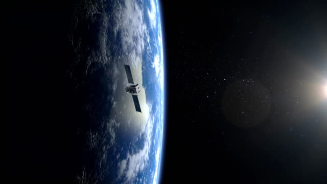 Flying satellite. The satellite appears in the frame and flies away. The earth is on the screen to the left.. 4K. NASA. Flying satellite. The satellite appears in the frame and flies away. The flight of the satellite over the Earth. The earth is on the screen to the left. 3D Animation. 4K. NASA. positioning stock videos & royalty-free footage
