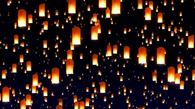 Flying sky lanterns in the night sky