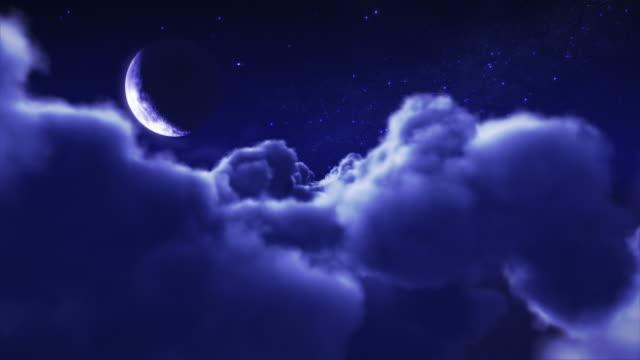 flying through clouds at night. crescent moon. loopable. - halvmåne form bildbanksvideor och videomaterial från bakom kulisserna