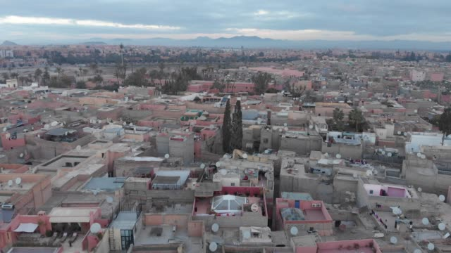 Flying through foliage in a Moroccan city - video