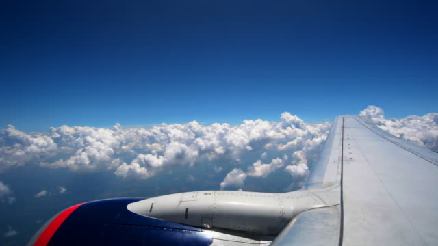Flying through puffy clouds video