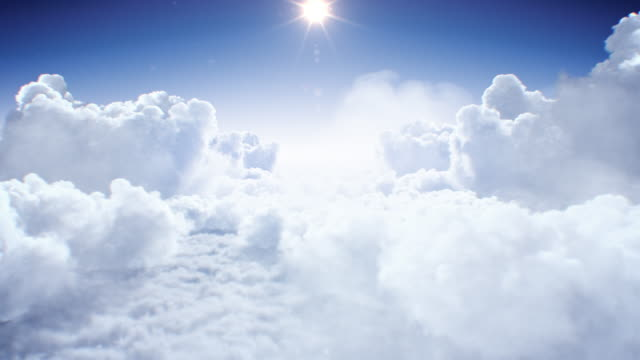 vídeos de stock e filmes b-roll de flying through the beautiful clouds with the shining bright sun daylight seamless. looped 3d animation flight above the realistic endless cloudscape under the afternoon sun. - padrão repetido