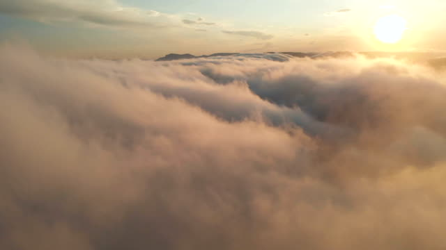 flying through the clouds at dusk or dawn. flying in pink clouds in the sun aerial view. - clouds stock videos & royalty-free footage
