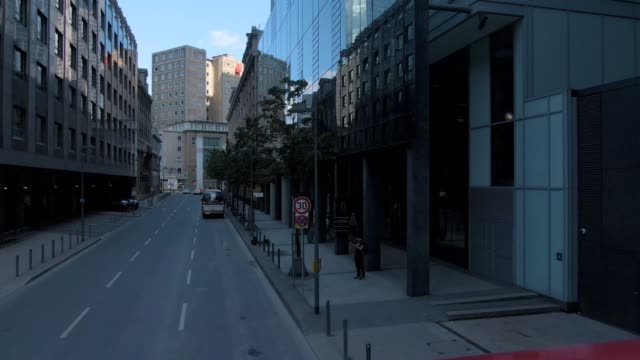 Flying through the streets of Frankfurt Flying through the streets of Frankfurt. Driving along downtown between tall buildings on an empty street. financial building stock videos & royalty-free footage