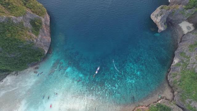 flying upwards above the Maya Bay with boats video