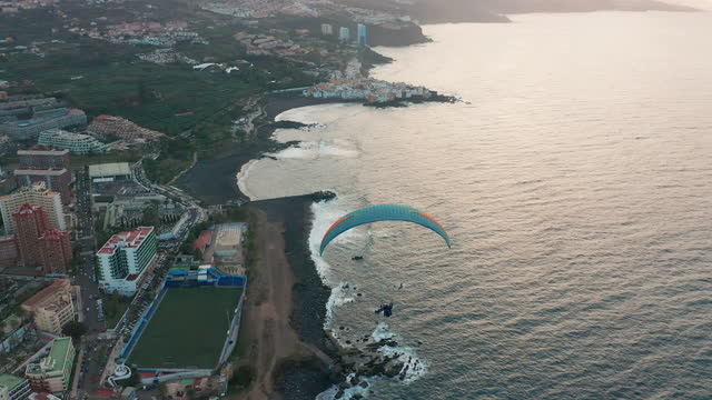 Flying with a paraglider high in sky. Paragliding, extreme sport