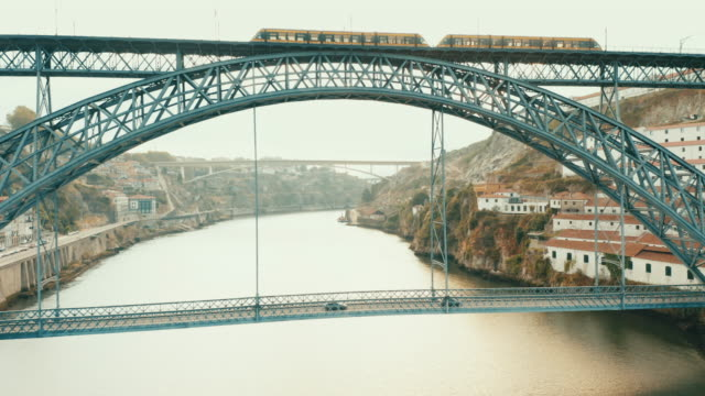 Flying with drone in Porto above town over the Douro river in Porto