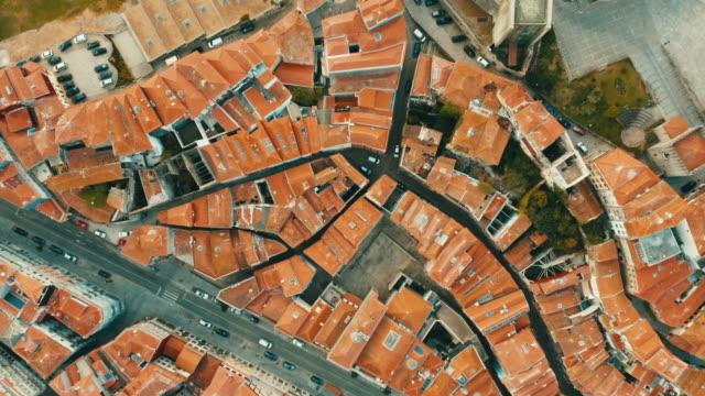vídeos de stock e filmes b-roll de flying with drone in porto above town over the douro river in porto - portugal