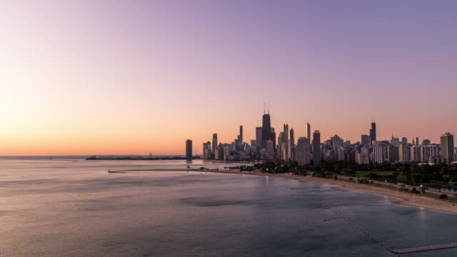 Flyover Lake Michigan - Chicago Cityscape Aerial View of Chicago Lake Shore Drive and North Avenue beach at Sunrise - October 2019 chicago stock videos & royalty-free footage