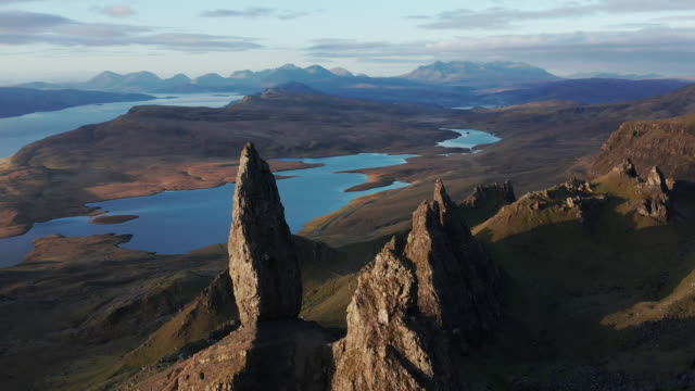 aerial: flyover of the old man of storr on the isle of skye - highlands scozzesi video stock e b–roll