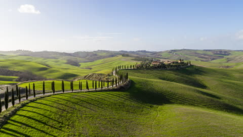 Flyover Rolling Hills of Tuscany Rolling hills of Tuscany - Asciano, Italy - Aerial View - Jan 2020 hill stock videos & royalty-free footage