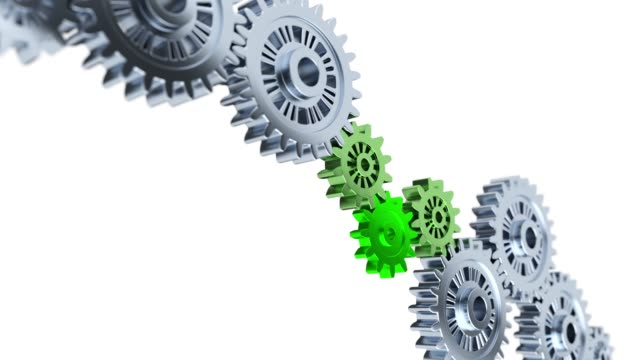 Focus on Three Green Gears with Some Gray and blurred Gears in Infinite Rotation