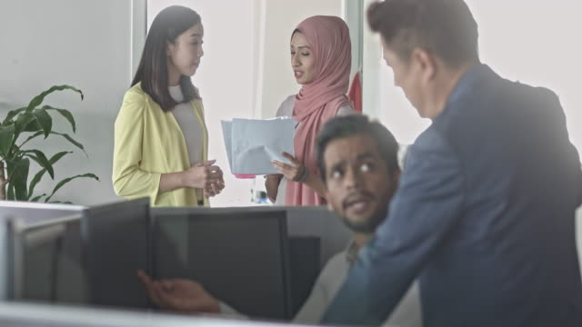 focus transition video of multi-ethnic asian business colleagues at office desk - office cubicle stock videos & royalty-free footage
