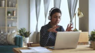 istock Focused indian woman distance teacher online tutor conferencing on laptop 1180677607