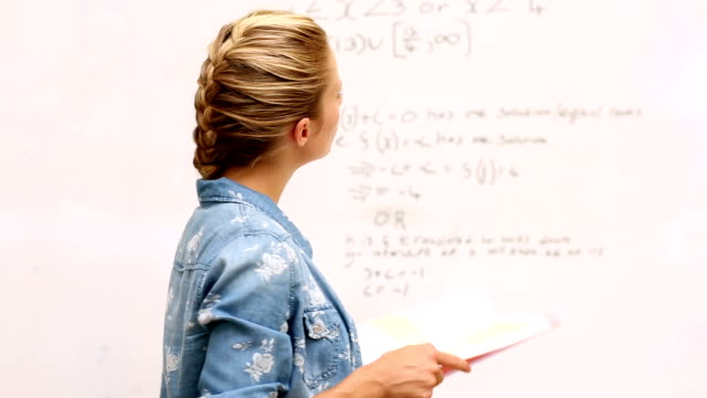 Focused student look at math on whiteboard in classroom Focused student look at math on whiteboard in classroom at the university whiteboard visual aid stock videos & royalty-free footage