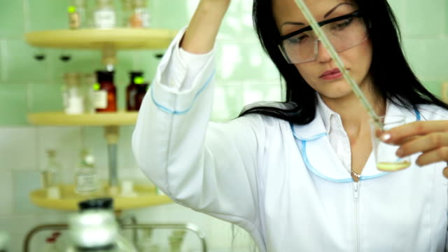 Focused woman scientist working in a lab video