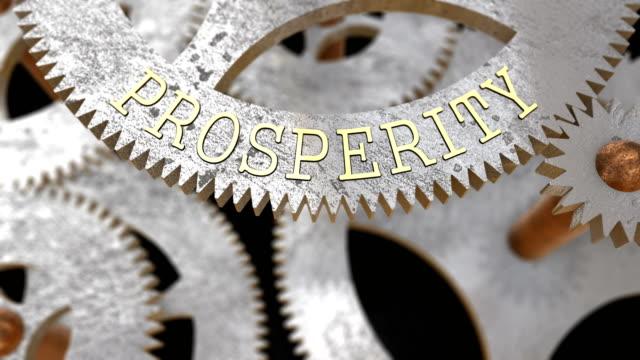 vídeos y material grabado en eventos de stock de se centra en la inscripción prosperidad en el engranaje - prosperidad