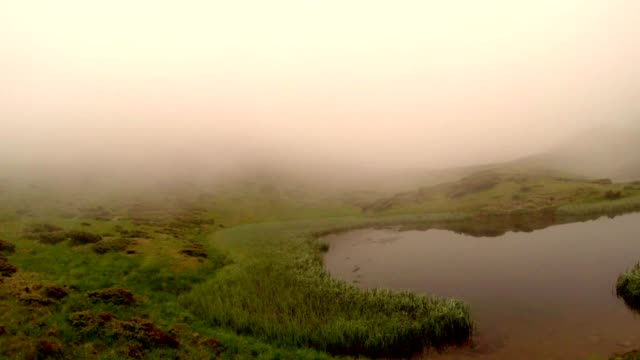 Fog Absorbs a Small Mountain Lake Panorama From Left to Right video