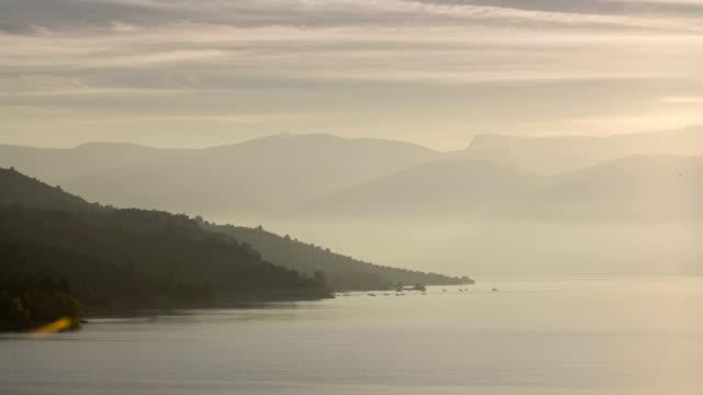Fog gathering at dawn on Lac de Sainte Croix lake Provence