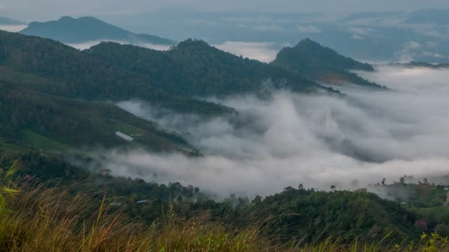 fog rolls across flowing over mountains,time lapse - tempio video stock e b–roll
