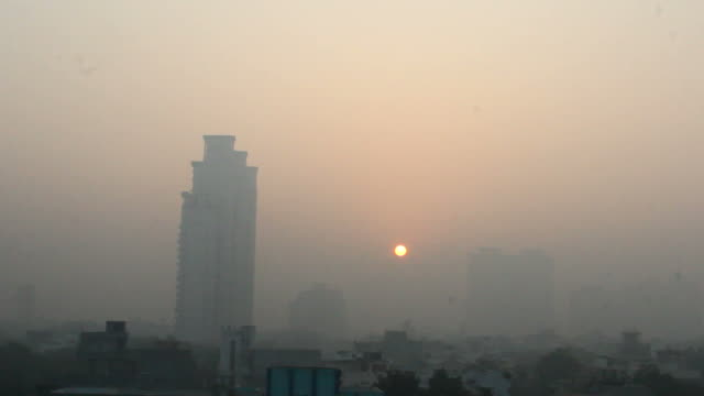 Foggy and misty morning sunrise Sunrise in the misty and foggy morning in a metropolitan city in India haryana stock videos & royalty-free footage