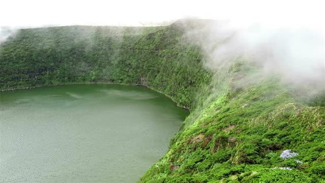 Foggy crater lake Lagoa Funda / Caldeira Funda, Flores Island, Azores video