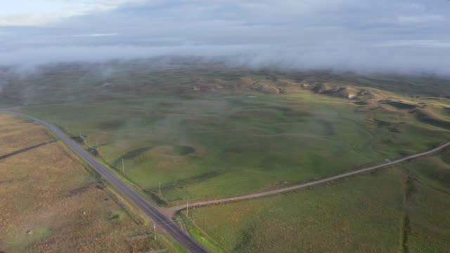 foggy morning over Nebraska Sandhills, aerial view