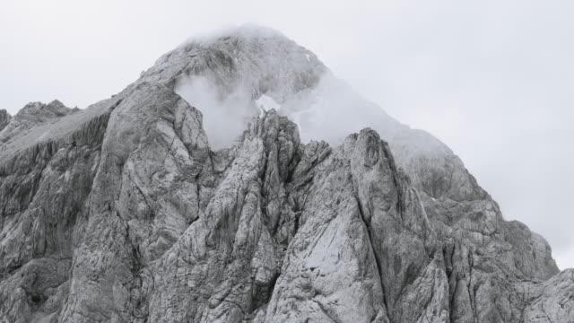 AERIAL Foggy rugged mountain top