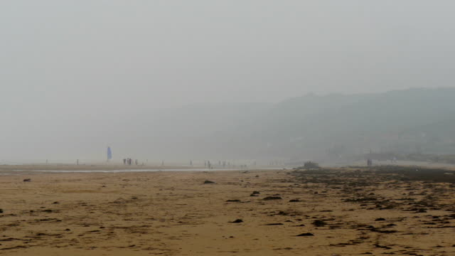 Foggy view of the sea shore in Omaha Beach Foggy view of the sea shore in Omaha Beach where the white sand is found and the small waves on the sea normandy stock videos & royalty-free footage