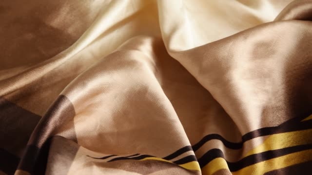 Folded silk golden tone cloth. Crop view of fashioned fabric piece Folded silk golden tone cloth. Crop view of fashioned fabric piece sari stock videos & royalty-free footage