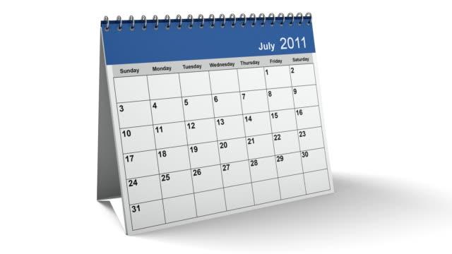 ripiegare 2011 calendario desktop blu con canale alfa - molla video stock e b–roll