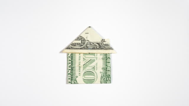 folding an origami house from one dollar bill (dollar bill origami) - symbol for real estate finances, mortgage payments - dollar bill stock videos & royalty-free footage