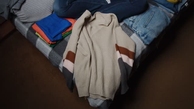 Folding and sorting clothing at home video