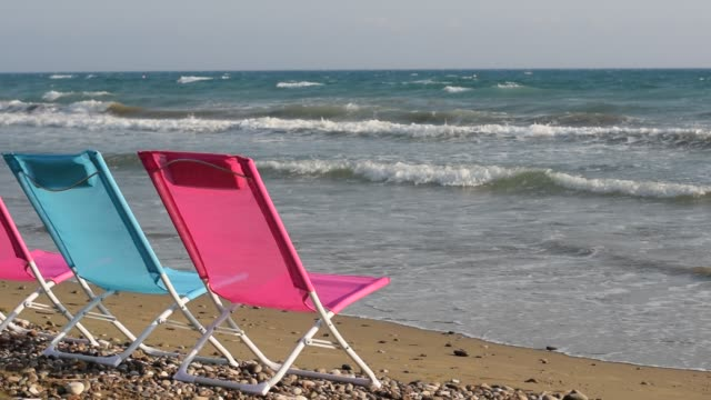 Folding chairs on the beach