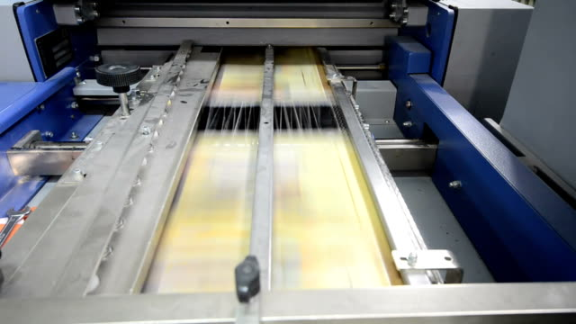 folding machine folds printed offset sheet newspaper, loopable - lithograph stock videos & royalty-free footage