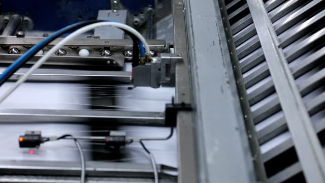 folding machine folds printed offset sheet - lithograph stock videos & royalty-free footage