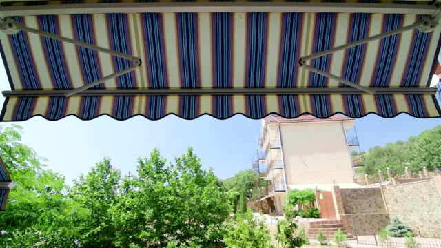 Folding retractable awning opening process video