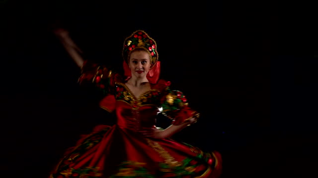 Folk dancer dancing on stage in national costume. video