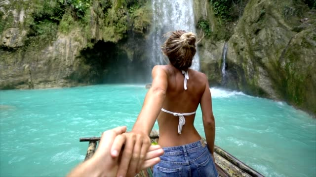 Follow me to concept young woman leading boyfriend to amazing waterfall, shot in Cebu Island, Visayas Islands, Philippines. Idyllic tropical travel journey vacations concept. Slow motion video Follow me to concept young woman leading boyfriend to amazing waterfall, shot in Cebu Island, Visayas Islands, Philippines. Idyllic tropical travel journey vacations concept. Slow motion video following moving activity stock videos & royalty-free footage
