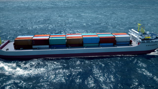 follow the container ship in ocean zoom out camera tracking - nave cisterna video stock e b–roll