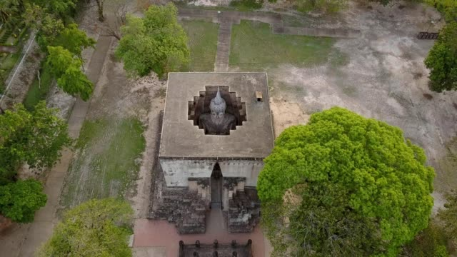 Follow up drone shot: Big buddha in Sukhothai historical park Thailand. Wat Si Chum is the most important and impressive temple compound in Sukhothai Historical Park. sukhothai stock videos & royalty-free footage