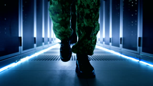 Follow up Shot of Soldier's Legs. He's Walking in Ultra Modern Top Secret Military Data Center Facility. video