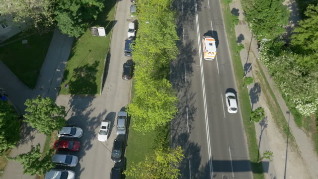 aerial following an emergency vehicle - ultra high definition television filmów i materiałów b-roll