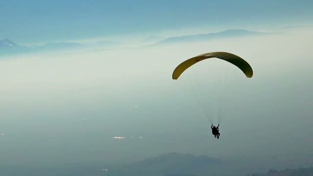 Following Parachute silhouette, Stock video video