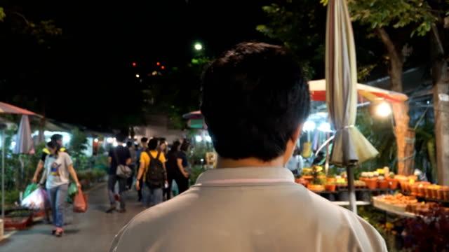 following Thai guy at a tree night market in Bangkok video