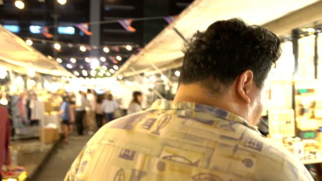 following Thai guy in night market in Bangkok video