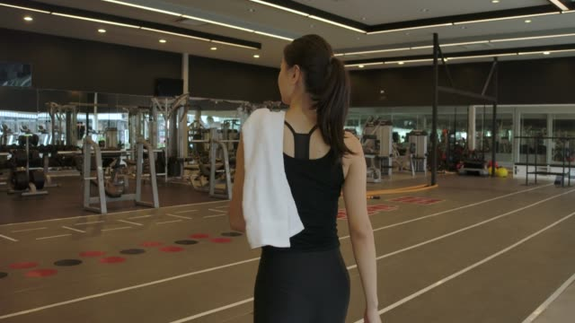 Follow-up Shot of Athletic Beautiful Asian Woman Entering Gym in Slow Motion. She's Confident and Pulls Her Ponytail. Exercising, Gym, Health Club, Women, Sport health club stock videos & royalty-free footage