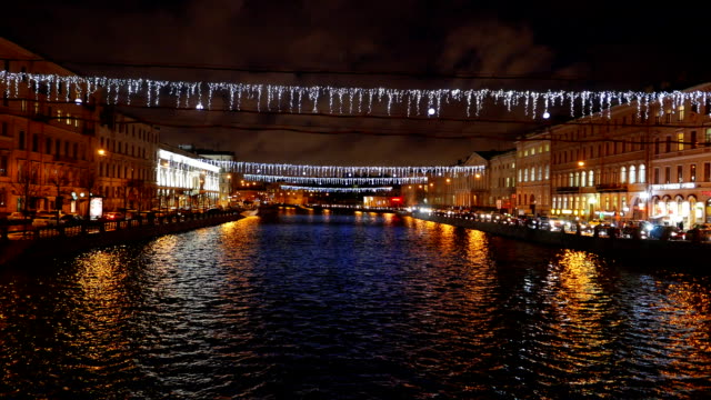 Fontanka river perspective at night, new year garland at Saint Petersburg video