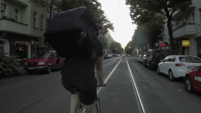 Food courier riding through Berlin Video series on bike messenger and bike food courier with different scenarios around Berlin city. food stock videos & royalty-free footage