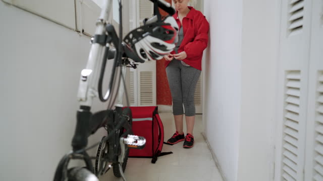 Food delivery woman getting ready for work video
